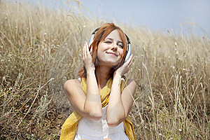 Beautiful Red-haired Girl At Grass With Headphones Royalty Free Stock Photography - Image: 15608207