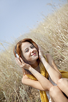 Beautiful Red-haired Girl At Grass With Headphones Stock Photo - Image: 15608220
