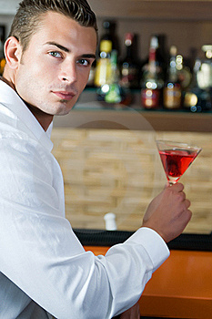 Man In A Pub With Red Martini Waiting Stock Photography - Image: 15608982