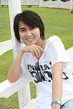 Thai Woman Sitting On A Bench Stock Images - Image: 15613184