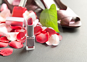 Lipstick With Scattered Rose Petals Royalty Free Stock Image - Image: 15624706