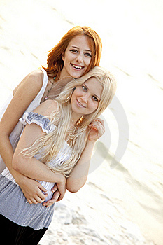 Two Beautiful Young Girlfriends On The Beach Stock Photos - Image: 15639743