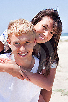 Girl Riding On Guy At Beach Stock Images - Image: 15651084