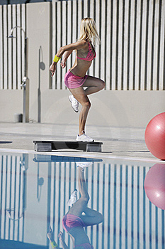Fitness Exercise At Poolside Stock Photo - Image: 15658450