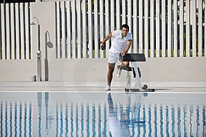 Young Man Exercise At Poolside Stock Photos - Image: 15659553