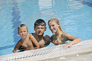 Happy Young Family Have Fun On Swimming Pool Stock Photos - Image: 15660233