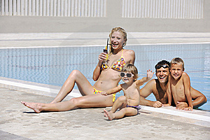 Happy Young Family Have Fun On Swimming Pool Stock Images - Image: 15660404