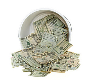 Twenty Dollar Bills Spilling Out Of Bucket Stock Photos - Image: 15672993