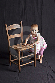 Baby Girl And Chair Stock Photography - Image: 15684942