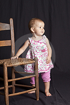 Baby Girl And Chair Royalty Free Stock Photography - Image: 15684977