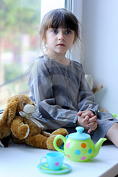 Nice Toddler Girl With Toy Tea Set And Bunny Stock Image - Image: 15686751