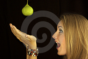 Girl And A Green Pear Royalty Free Stock Image - Image: 15690816