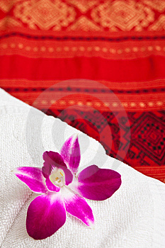 White Towel And Orchid Stock Photos - Image: 15701013