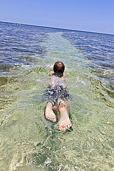 Boy Enjoys The Clear Ocean Royalty Free Stock Photography - Image: 15702937