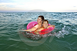 Brothers In A Swim Ring Have Fun In The Ocean Royalty Free Stock Photo - Image: 15703625