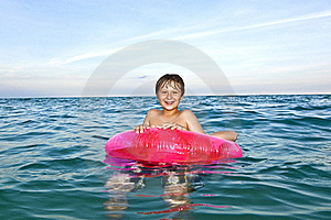 Brothers In A Swim Ring Have Fun In The Ocean Royalty Free Stock Image - Image: 15703836