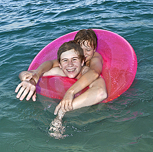 Brothers In A Swim Ring Have Fun In The Ocean Royalty Free Stock Photos - Image: 15704308