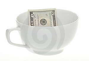 Five Dollar Bill In A White Mug Cup Stock Photography - Image: 15715312