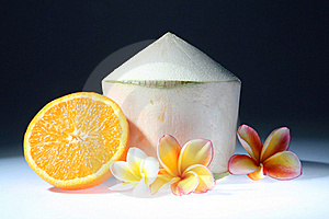 Coconut And Orange With Three Lan Thom Flowers Stock Photos - Image: 15716443