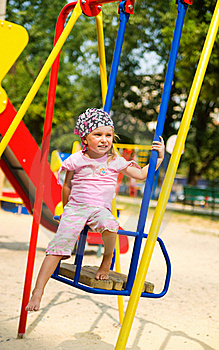 Little Girl On Seesaw Royalty Free Stock Photography - Image: 15718317