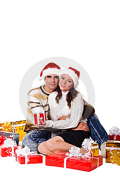 Christmas Couple With Gift Boxes Stock Photo - Image: 15718340