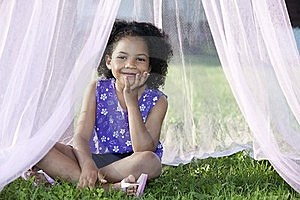 Girl Sitting In Her Canopy Stock Photography - Image: 15728272
