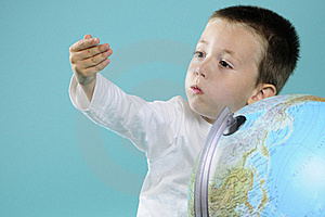 Caucasian Child Evaluating Destinations On Globe Stock Images - Image: 15733634