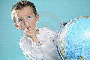 One Child Evaluating Destinations On Globe Stock Photography - Image: 15733642
