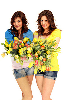 Two Girls With Flowers Royalty Free Stock Photos - Image: 15740058