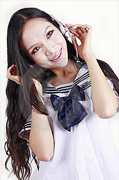 Asian Schoolgirl Enjoying Music Royalty Free Stock Images - Image: 15747909