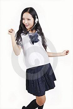 Asian Schoolgirl Enjoying Music Royalty Free Stock Photo - Image: 15747945