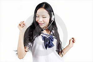 Asian Schoolgirl Enjoying Music Stock Image - Image: 15747971