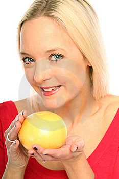 Blond Woman With A Grapefruit Stock Photo - Image: 15754320