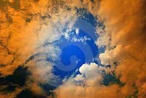 Puffy Clouds With Orange Overlay Royalty Free Stock Photo - Image: 15761075