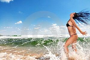 Beautiful Girl Splashing In The Ocean Royalty Free Stock Image - Image: 15761336
