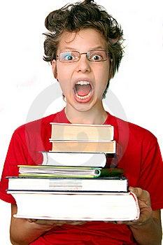 Shocked Boy With Set Of Books Stock Photo - Image: 15761590
