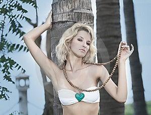 Woman Near Trunk Of Palmtree Stock Image - Image: 15765711