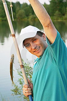 Smiling Fisherman With A Rod And A Fish Royalty Free Stock Image - Image: 15767906