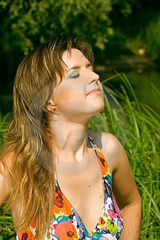Girl Relaxing On The Lawn Stock Photo - Image: 15768480