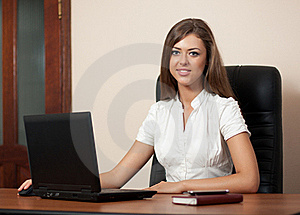 Young Woman Behind A Table With The Laptop Stock Photo - Image: 15788730