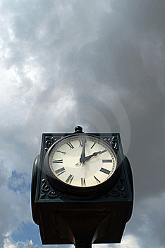 Clock Against Moody Sky Stock Image - Image: 15791351