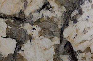 Granite. Pale Yellow And Reddish-brown Shades. Royalty Free Stock Images - Image: 15801039