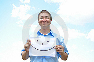 A Young Man Holds A Sheet Of Paper Stock Photos - Image: 15807263