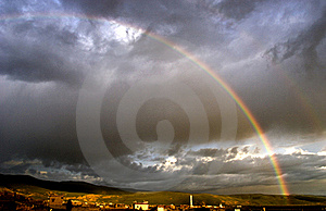 Rainbow in heavy cloud Stock Photography