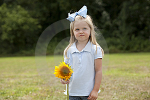 Little Girl Holding A Flower Royalty Free Stock Images - Image: 15849119