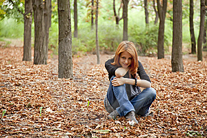 Beautiful Red-haired Girl In Autumn Park Royalty Free Stock Images - Image: 15849819