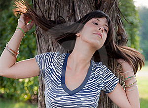 Sexy Young Woman Flipping Hair In Front Of Tree Royalty Free Stock Image - Image: 15862906