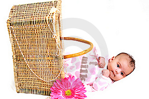 Newborn Baby Girl In A Basket, Beads And Flower Royalty Free Stock Image - Image: 15869026