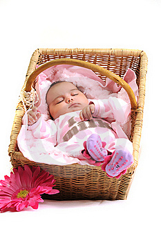 Newborn Baby Girl In A Basket, White Beads Royalty Free Stock Image - Image: 15869036
