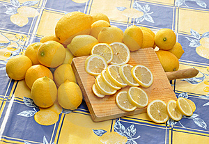 Lemons And Wood Cutting Board Royalty Free Stock Photo - Image: 15873895